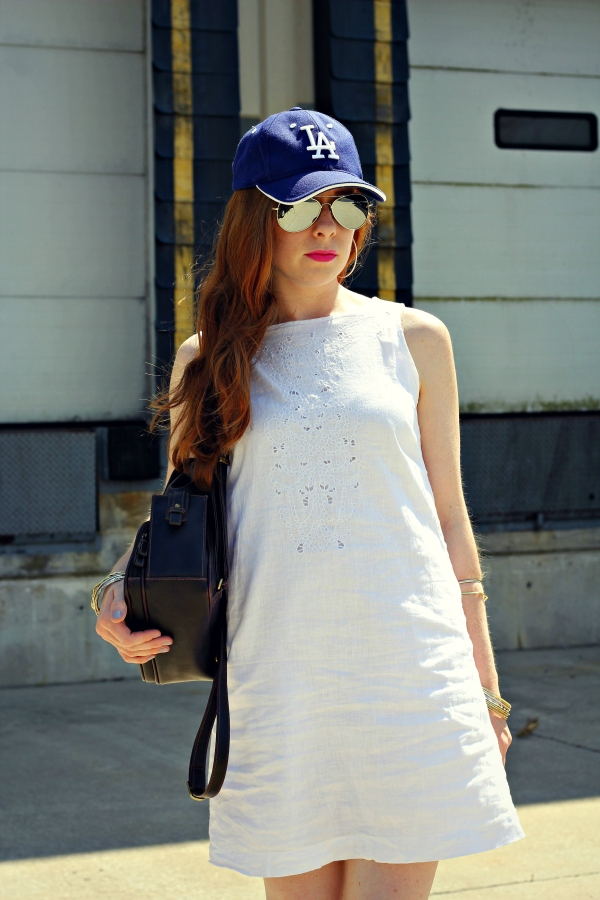 LA baseball hat, white linen dress, floral wedges, gold and silver bangles, mirrored sunglasses, brown backpack - Knocked Up Fabulous