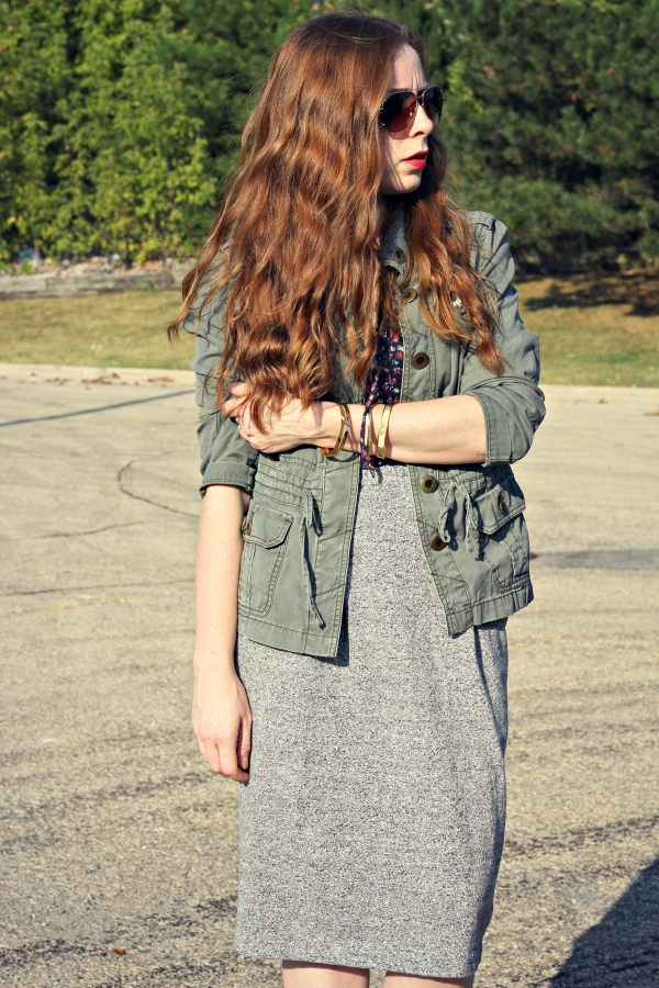 green army jacket, floral blouse, gray skirt, red lips, wavy red hair, fall outfit
