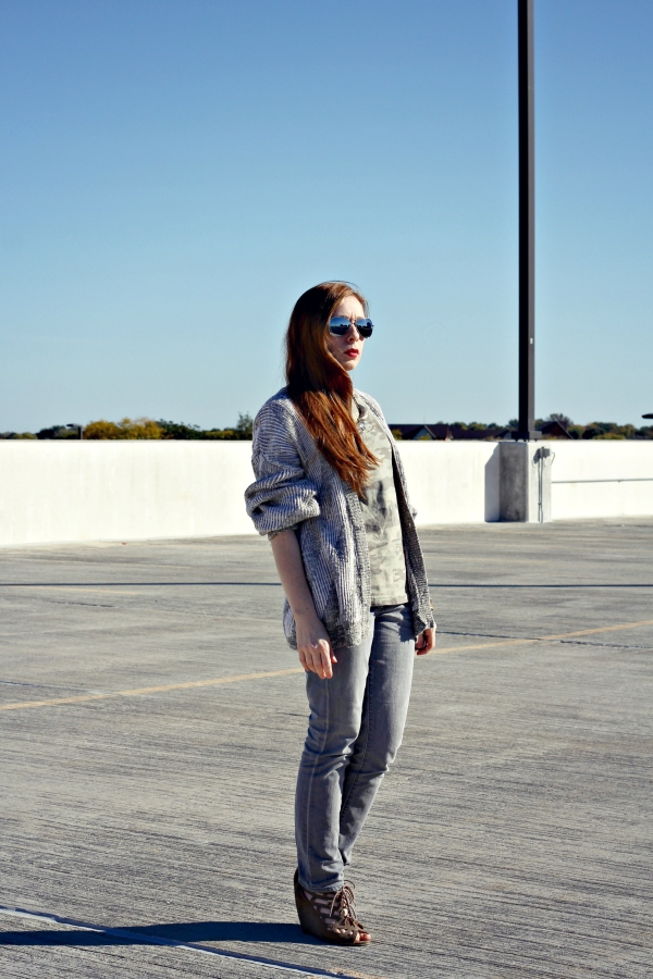 gray skinny jeans with an over-sized cardigan